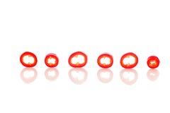 Pedazos de la pimienta dispuestos en el fondo blanco Imágenes de archivo libres de regalías