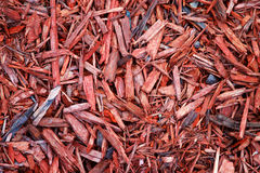 Pedazos de madera rojos imagenes de archivo