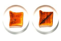 Pedazos de pan asados a la parrilla Foto de archivo libre de regalías