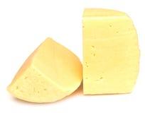 Pedazos de queso aislados Imágenes de archivo libres de regalías