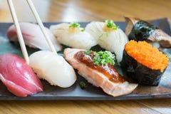 8 pedazos de sushi Imágenes de archivo libres de regalías