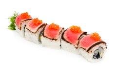 Pedazos de sushi con una carne y un caviar Fotografía de archivo