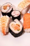 Pedazos de sushi en el fondo blanco Fotografía de archivo libre de regalías