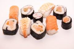 Pedazos de sushi en el fondo blanco Imagen de archivo libre de regalías