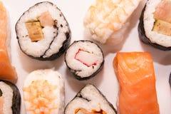 Pedazos de sushi en el fondo blanco Imágenes de archivo libres de regalías