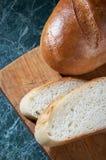 Pedazos de un pan blanco Fotografía de archivo libre de regalías