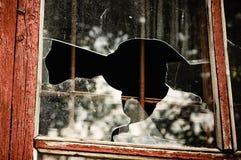 Pedazos de una ventana quebrada Imagen de archivo