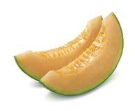 Pedazos del cantalupo del melón aislados en blanco imágenes de archivo libres de regalías