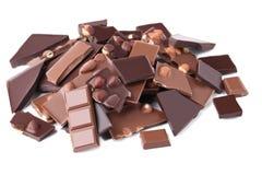 Pedazos del chocolate con las avellanas Foto de archivo