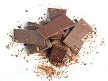Pedazos del chocolate con las tuercas Fotos de archivo libres de regalías