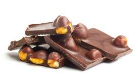 Pedazos del chocolate con las tuercas Foto de archivo