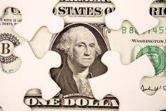 Pedazos del dólar y del rompecabezas Fotos de archivo