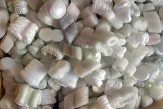 Pedazos del embalaje de la espuma de poliestireno Fotografía de archivo