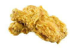 Pedazos del pollo frito aislados en el fondo blanco Imagen de archivo