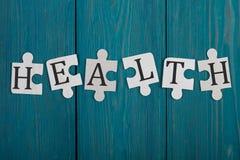 Pedazos del rompecabezas con palabra y x22; Health& x22; Imagen de archivo libre de regalías