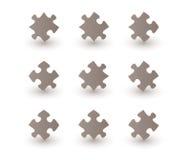Pedazos del rompecabezas de Brown Imagen de archivo libre de regalías
