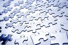 Pedazos del rompecabezas de rompecabezas Imágenes de archivo libres de regalías