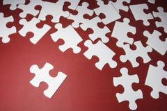 Pedazos del rompecabezas de rompecabezas Foto de archivo libre de regalías