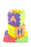 Pedazos del rompecabezas del alfabeto Fotografía de archivo libre de regalías