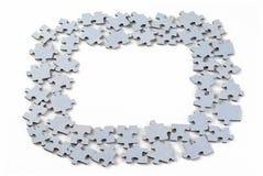 Pedazos del rompecabezas en el fondo blanco Imágenes de archivo libres de regalías