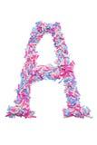 Pedazos del rosa y del purpleletter A de papel coloreado Fotografía de archivo