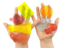 Pedazos hechos a mano del color de jabón en palmas de los niños Foto de archivo libre de regalías