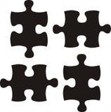 Pedazos negros básicos del rompecabezas Foto de archivo
