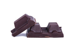 Pedazos negros de la barra del chocolate con leche Foto de archivo libre de regalías