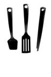 Pedazos negros de los utensilios de cocina imagenes de archivo