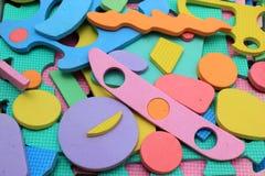 Pedazos plásticos del rompecabezas de los niños del recorte fotografía de archivo libre de regalías