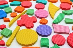 Pedazos plásticos del rompecabezas de los niños del recorte foto de archivo libre de regalías