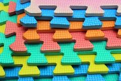 Pedazos plásticos del rompecabezas de los niños del recorte imagen de archivo libre de regalías