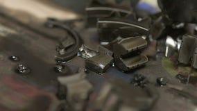 Pedazos quebrados de engranaje dañado de la caja de cambios de la motocicleta metrajes