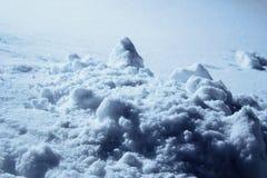 Pedazos quebrados de nieve fotos de archivo
