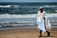 Peddler at the beach Stock Photography