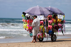 Peddler at the beach Royalty Free Stock Image