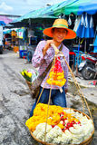 Peddler. Sale flower at market he is friendly Royalty Free Stock Photo