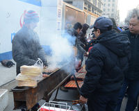 Vendor selling kebab. Vendor selling roasted mutton cubes on spit at  antique market Tianjin China photoed on january 23th 2014 Royalty Free Stock Images
