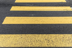 Pederastian crossing in asphalt street and abstract background Royalty Free Stock Photo