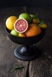 Pedestal bowl of assorted fresh citrus fruit Stock Photos