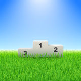 Pedestal with numbers on the green grass soccer field. Pedestal with numbers on the green grass field Royalty Free Stock Photos