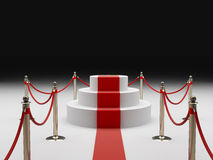 Pedestal with the red carpet and fence Stock Images
