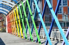 Pedestrain Bridge structure with rainbow colors. Metal Pedestrain Bridge structure with rainbow colors located in Aviles, Asturias, Spain, this is during Spring stock photography