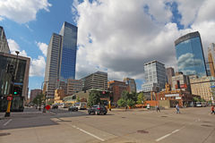 Pedestrain and car traffic and a partial skyline of Minneapolis, Royalty Free Stock Photography