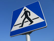 Pedestrian. (Pedestrian sign) crossing on the blue sky Royalty Free Stock Image