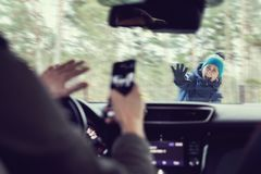Free Pedestrian Accident - Man Using A Phone While Driving A Car Stock Photography - 163839502