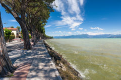 Pedestrian alley on the banks of Garda lake Stock Photos