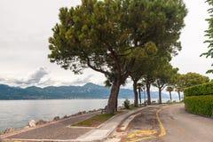 Pedestrian alley on the banks of Garda lake stock photography