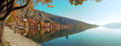 Pedestrian alley on the banks of lake. Orestiada in Kastoria , Greece at autumn royalty free stock photography