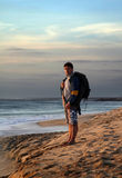 The pedestrian with a backpack. On a background of a sea landscape Royalty Free Stock Image